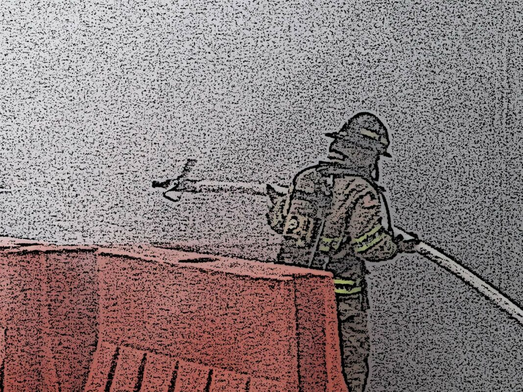 Firefighter with a hoseline