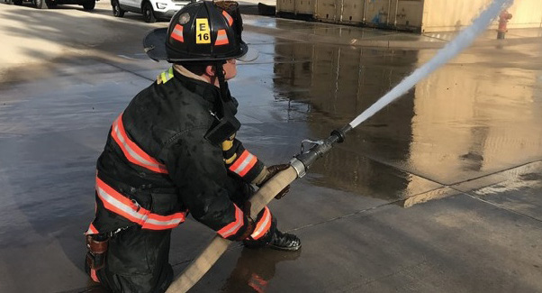 With proper technique, a single firefighter is capable of deploying and operating a medium-diameter handline. (Photo by Shawn Duncan.)