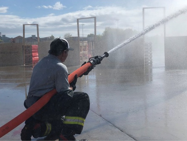 A ground-based hose handling position will increase the duration in which a nozzle firefighter is able to flow water. Allowing more of the hoseline to contact the ground will allow its weight and friction to aid in countering nozzle reaction. (Photo by author.)
