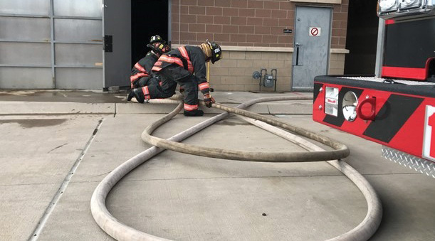 Intentional efforts to lay out hose properly will lead to crew efficiencies and decrease overall fatigue. The sections of hose that will move first during an advance should never be underneath portions that will remain static. (Photo by Shawn Duncan.)