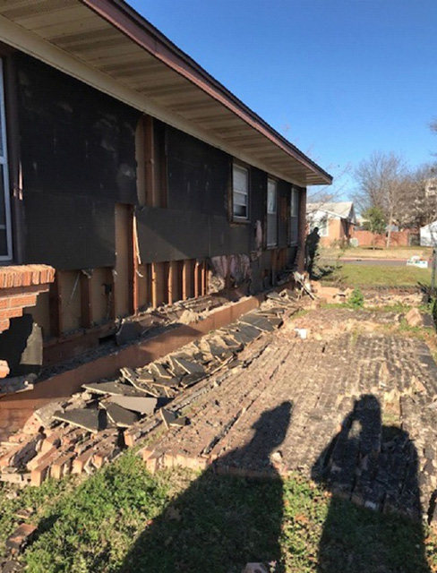 The after-effects of the explosion. As you can see, some bricks have been blown off.