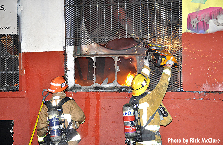 Crews cut open a window.