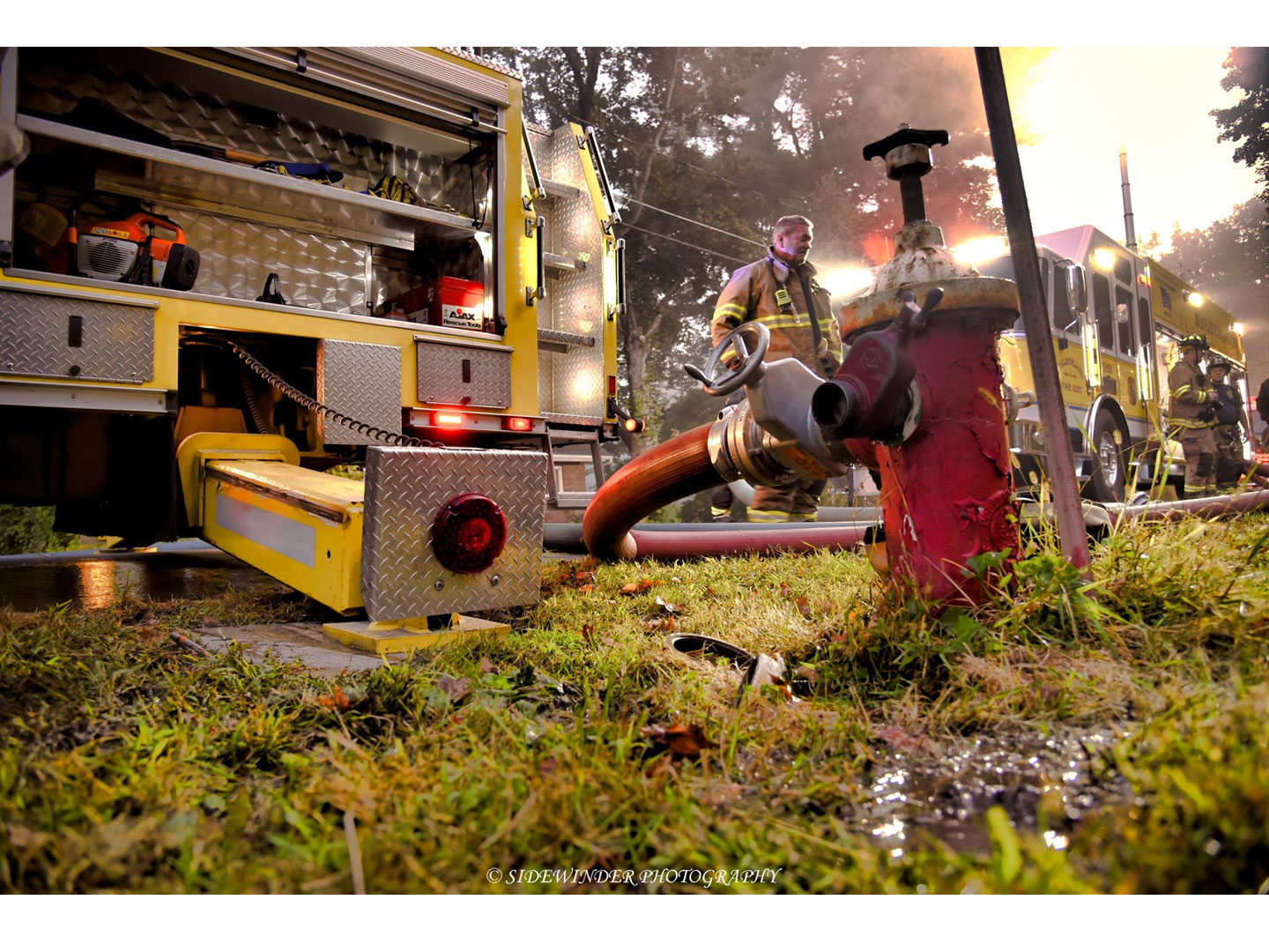 Hydrant hookup and fire apparatus at the scene.