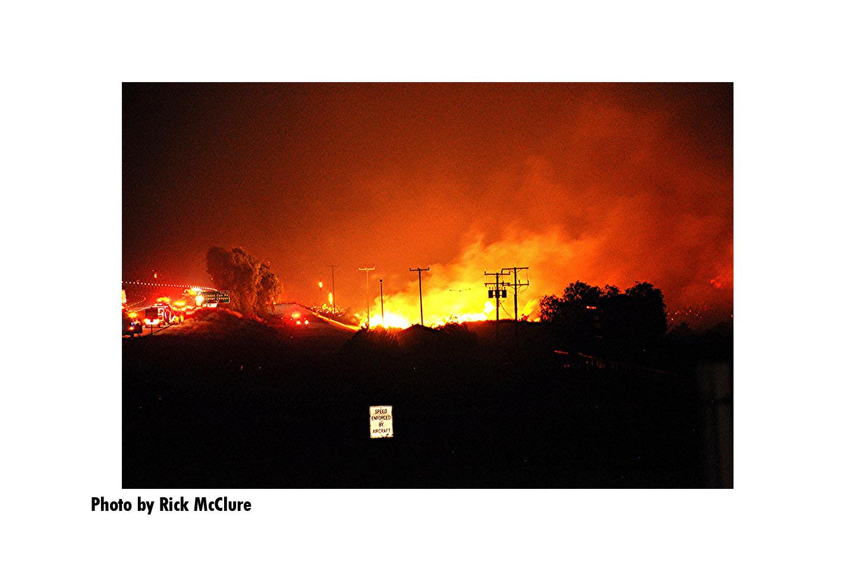 Flames illuminate power lines