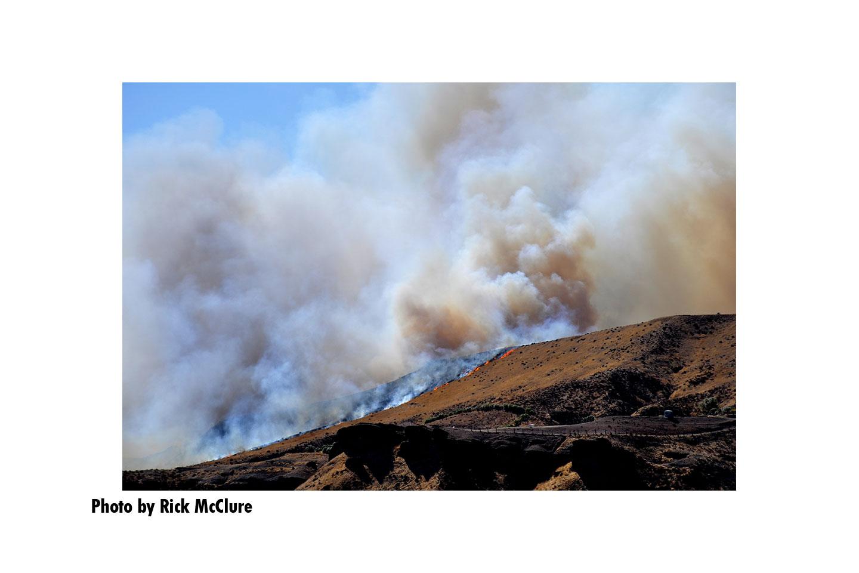 Flames and smoke on a hillside