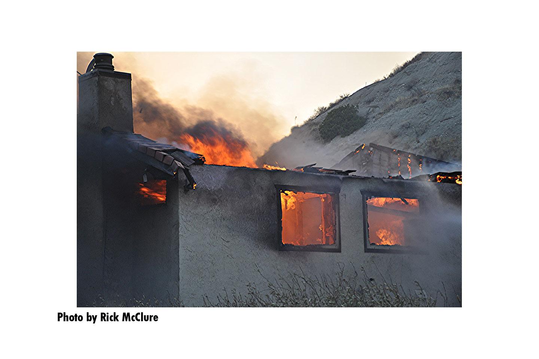 Flames rip through a structure