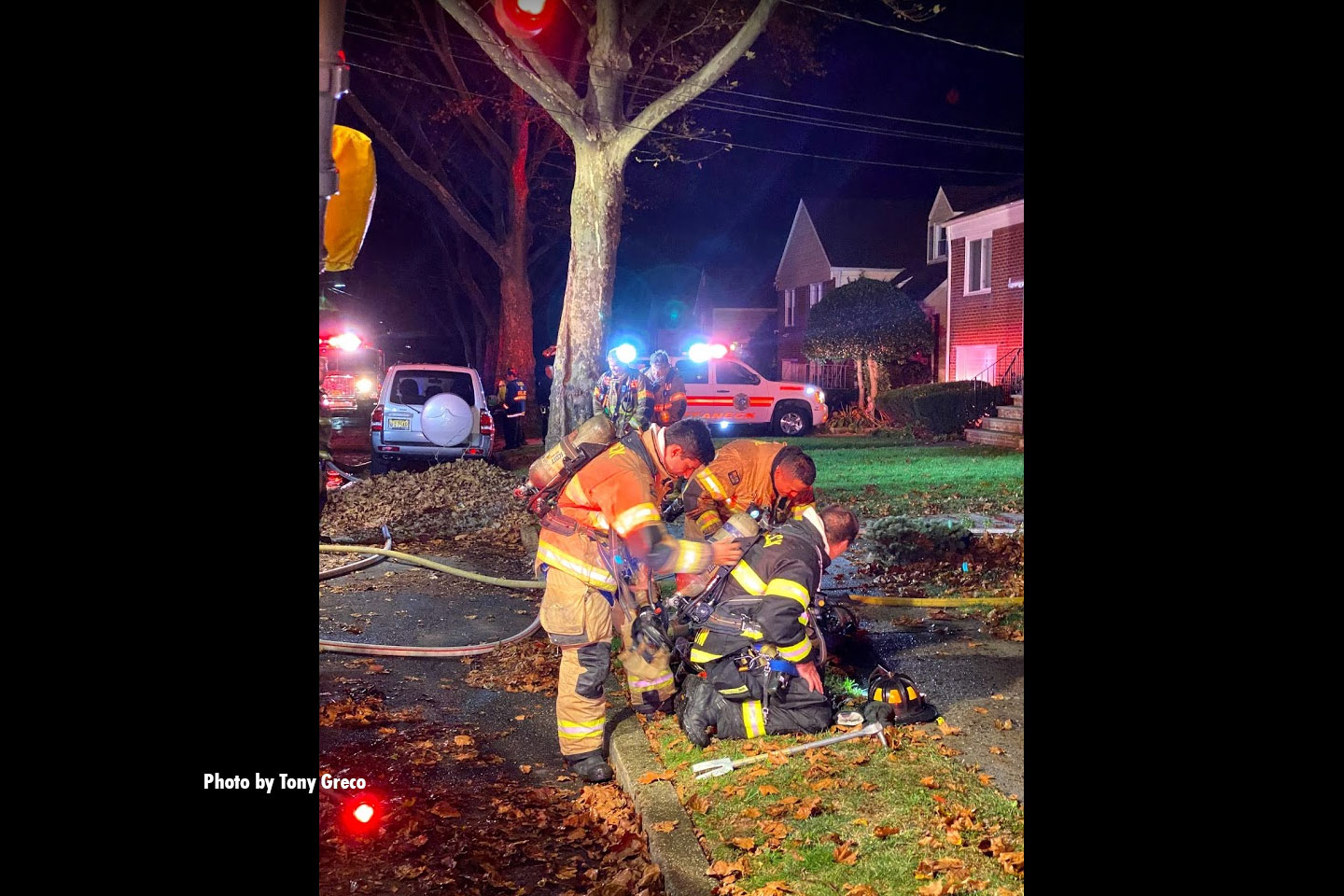 Firefighters assist another member.
