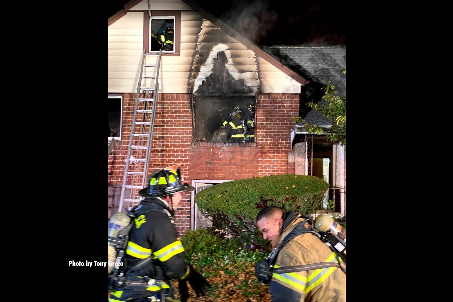 Firefighters at the scene of the residential fire.