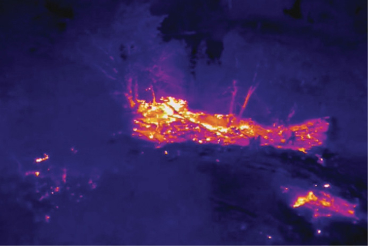 Thermal imaging views streamed to command help them decide where to land fire crews off of rescue boats for a fire on an island in the middle of the Sacramento River at night in Sacramento, California.
