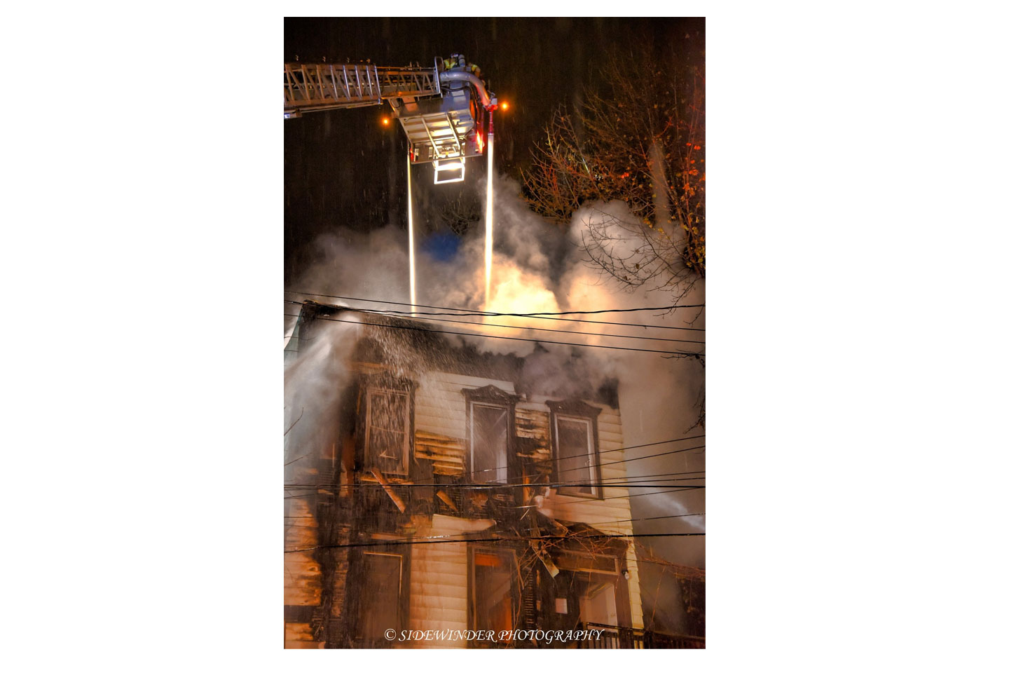 Aerial stream in use at house fire.