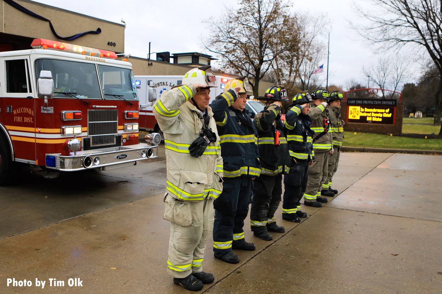 Firefighters salute the late chief.