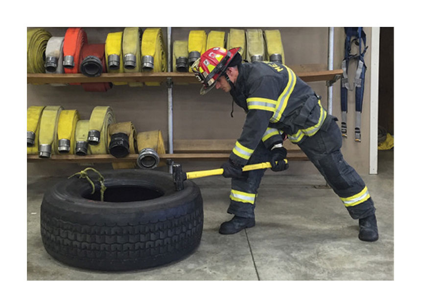 Firefighter exercising in the firehouse
