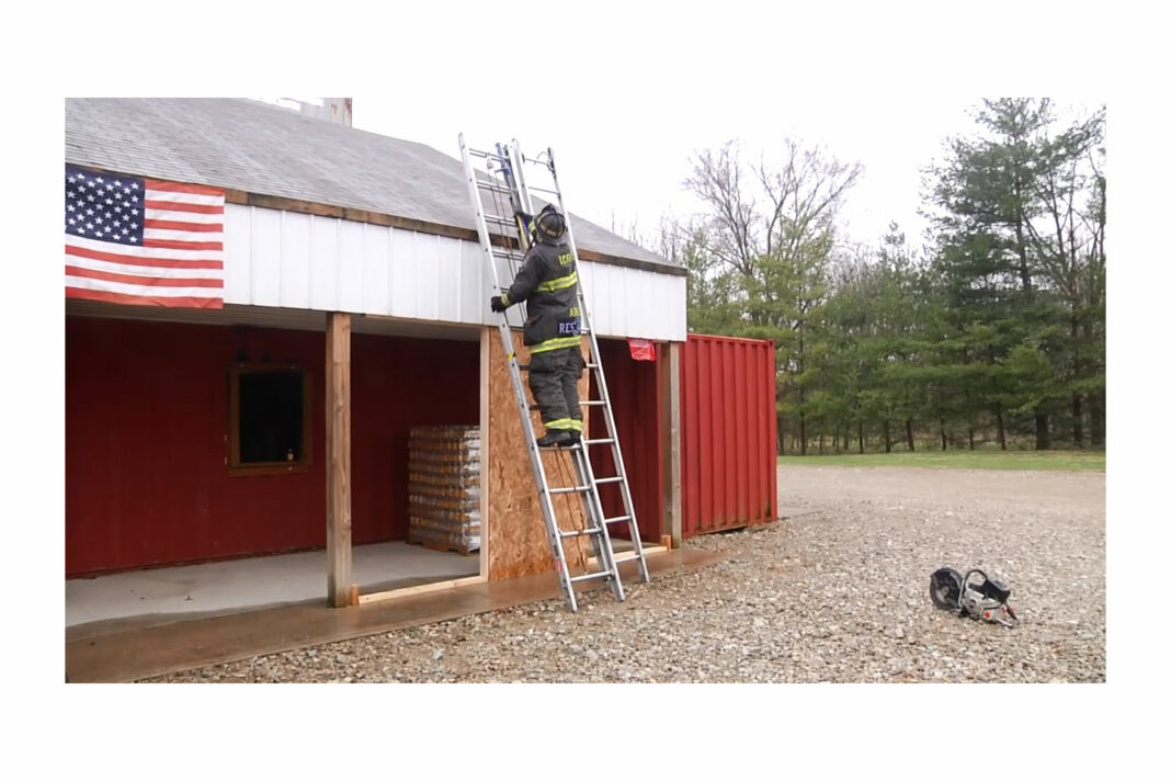 Firefighter deploying multiple ladders