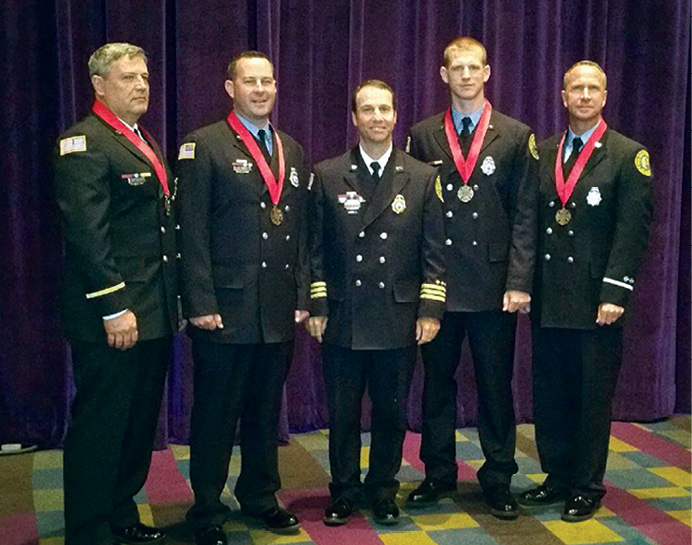 The crew of Engine 17 immediately after receiving the 2015 IAFC/Motorola Solutions Ben Franklin Award for Valor. (Photo courtesy of Chief Michael J. Barakey.).
