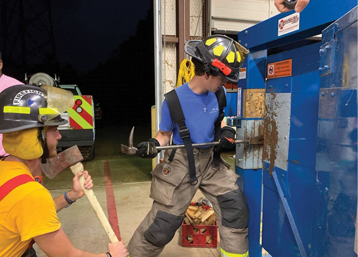 A firefighter trains on forcible entry.