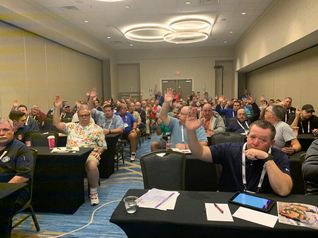 Raised hands at firefighter meeting