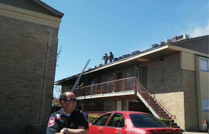 Firefighters attempted to access the fire below the peaked roof. [Photos courtesy of the Greenville (TX) Fire Department.]