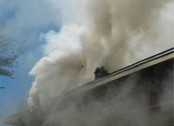 Minutes later, firefighters were injured after falling through the peaked roof