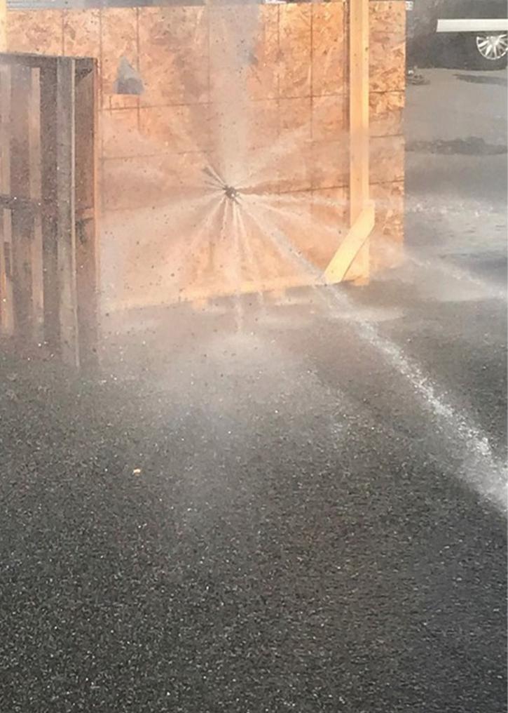 A piercing nozzle application spray pattern.