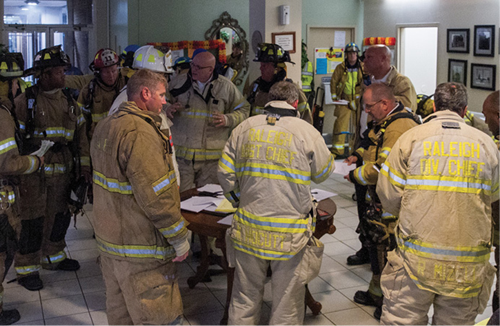 The command post was in the lobby. The postincident review recommended, when possible, placing the command post in a remote area. In the lobby, all the incident management personnel were in the path of incoming personnel and evacuating residents.