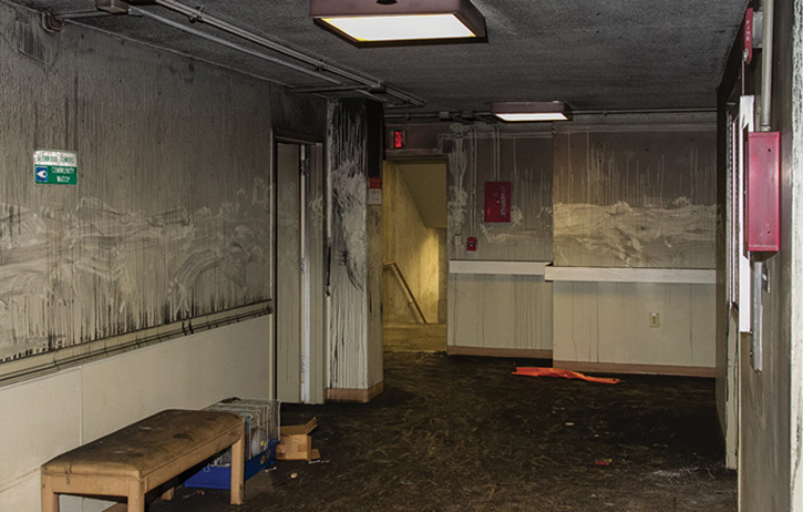 The smudged areas in the middle of the walls are indications of the oriented search by personnel under no-visibility conditions.