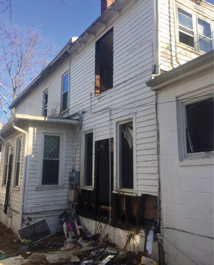 This fire in a crawlspace occurred in a balloon-frame duplex in Mount Holly Township, New Jersey, in February 2018. This was a natural gas-fed fire from a ¾-inch flexible gas line that was compromised by fire. The gas line ran from the full basement of the original foundation of the residence to the additions in the rear. Note the changes in the roof line and exterior building material where the two additions were located. (Photos by Lieutenant Bryan Iannacone.)