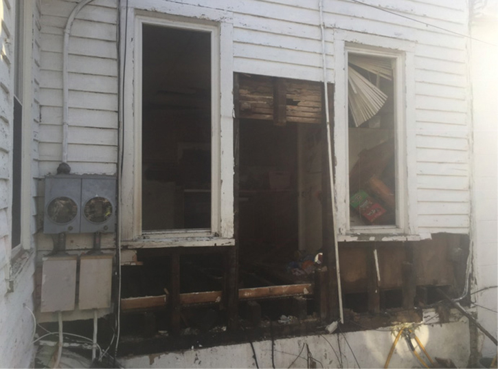 The exterior lap siding was then removed with chain saws to gain access. The reach of the stream from the second line on the exterior successfully knocked down the fire once the free-flowing natural gas was shut off.