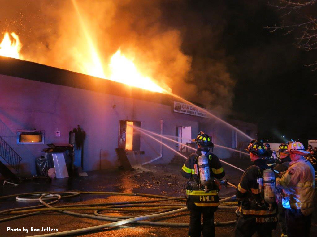 Multiple streams in use as fire vents through the roof of the structure.