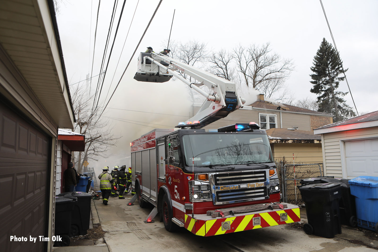 Chicago firefighters in a bucket at the fire scene