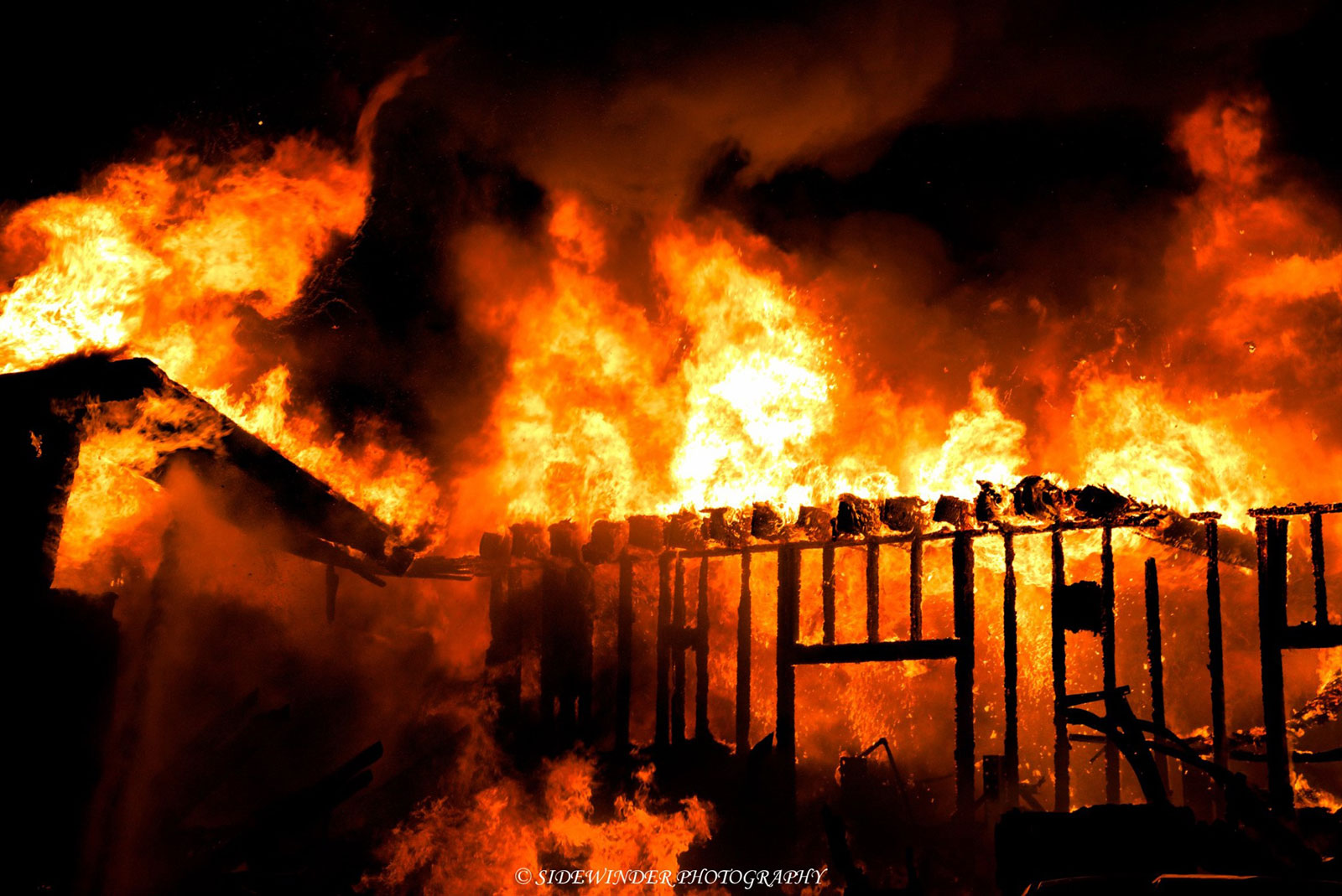 Flames tear through the structure