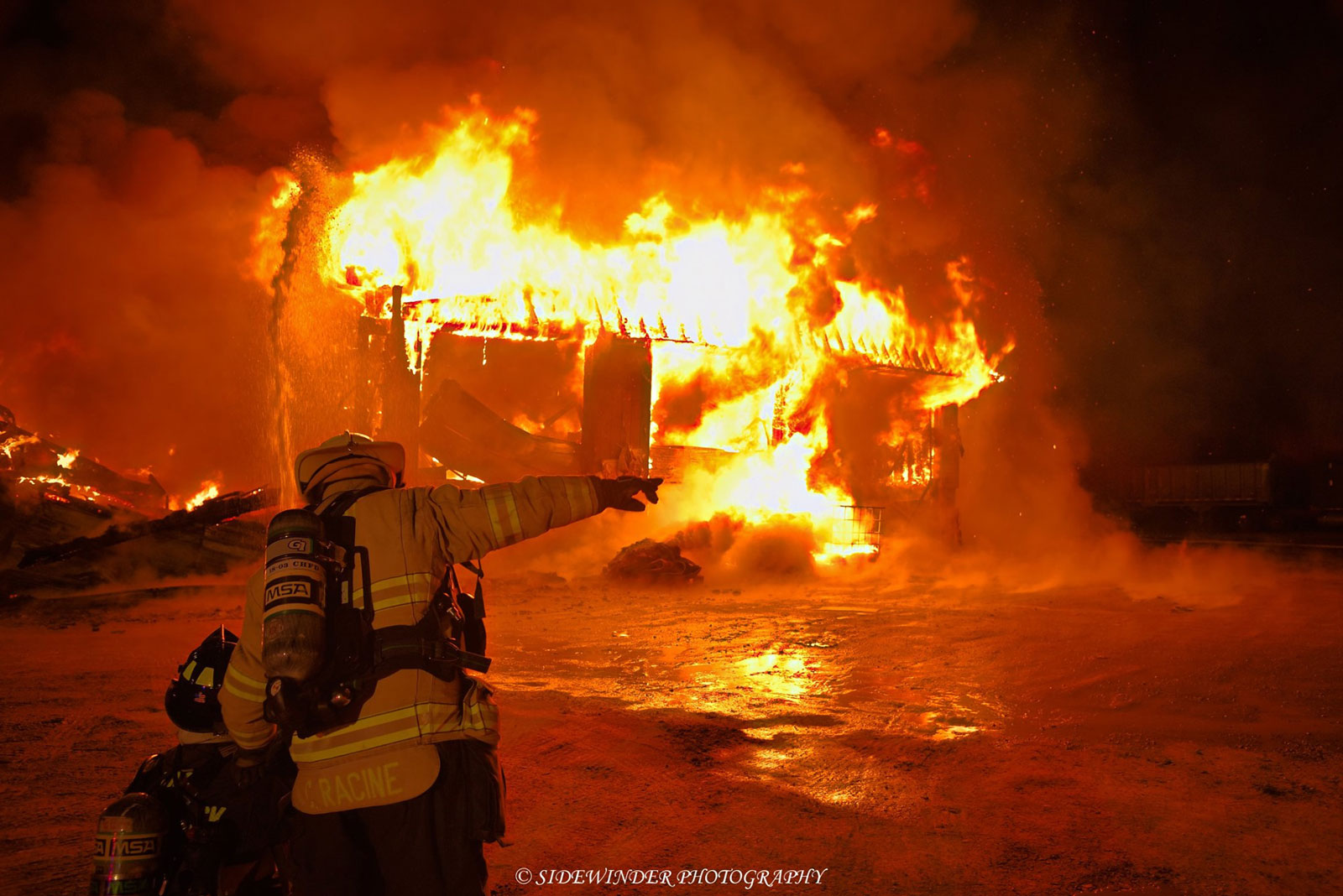 Firefighter at the scene of a major fire in Schodack, New York