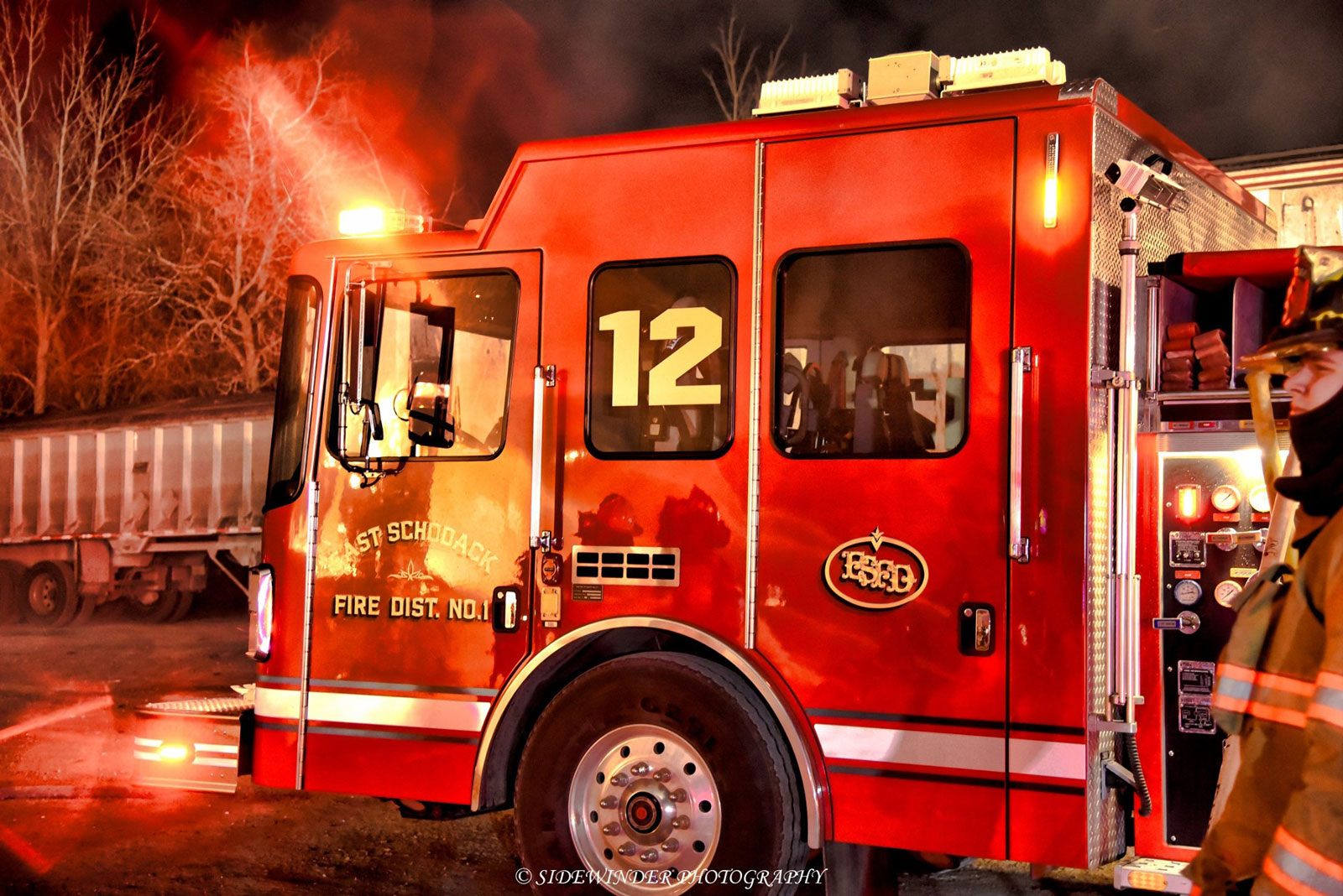 Fire apparatus with light from the flames reflecting on it