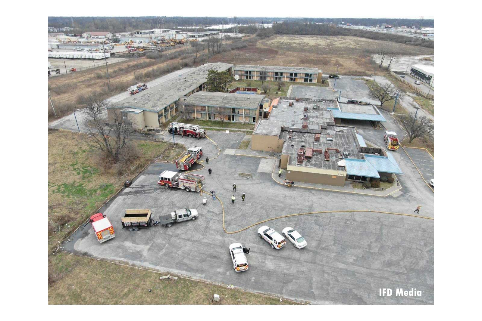 A birds-eye-view of the fire scene with apparatus and complex layout