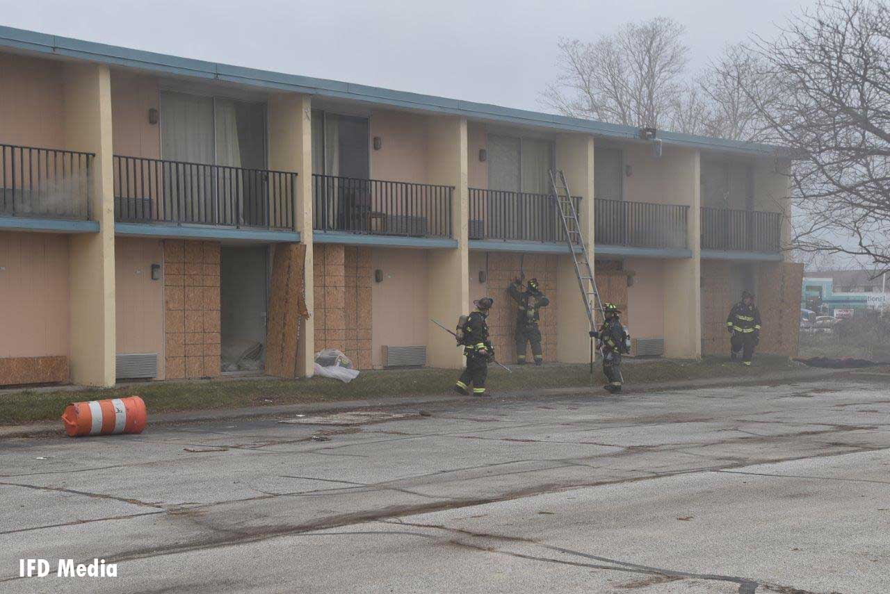 Firefighters at the scene of a fire at a former motel