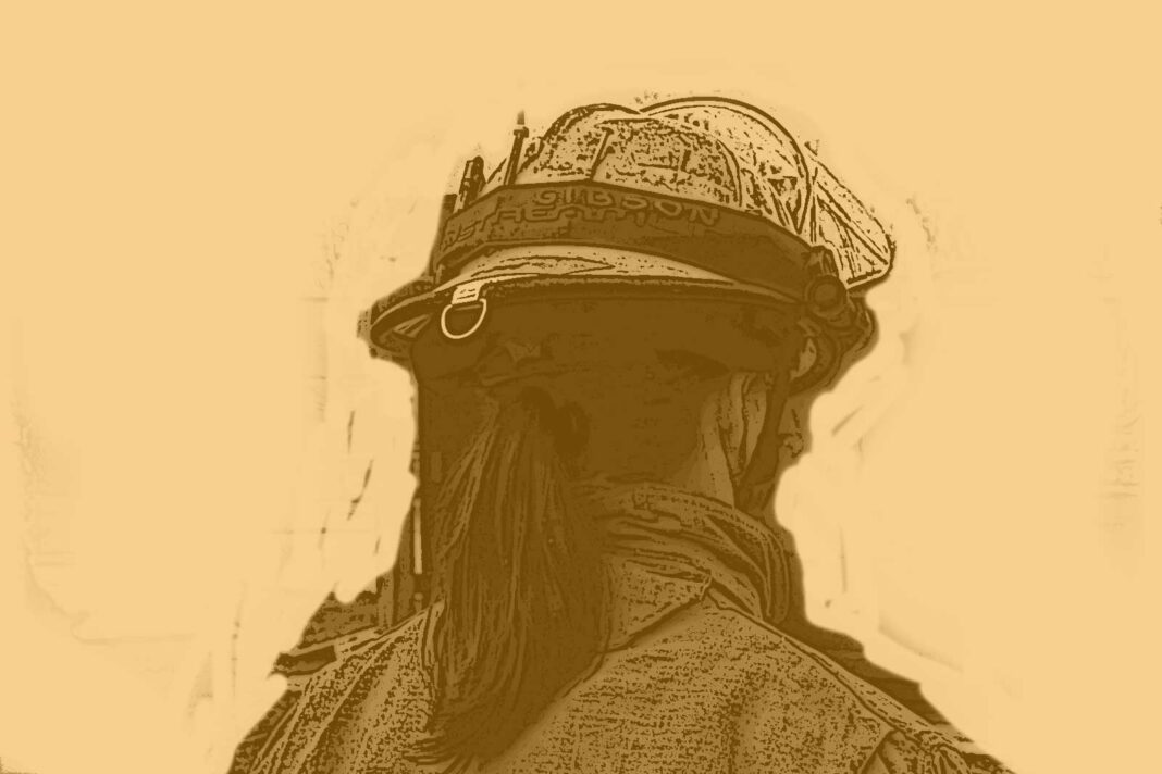 Firefighter with a ponytail in a fire helmet