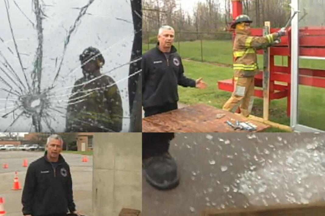 John Buckheit and other firefighters on breaking glass windows