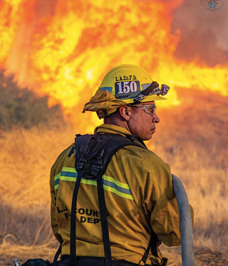 PELICANPRODUCTS selected Daniel Biggs' photograph of Los Angeles County (CA) Fire Department FirefighterRaul Perez as he fought the Tick Fire in Santa Clarita, California, in October 2019 as the company's second winning image in itsPortraits of Protectionphoto competition.