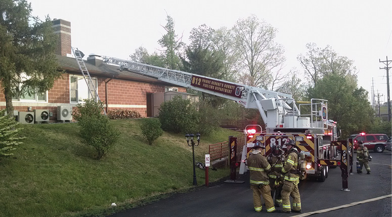 Who made it to the roof first? The firefighters throwing the ladders gained access more quickly and easily. Although you could use the big ladder up top, it may not be most appropriate for the situation, which depends on staffing and conditions.