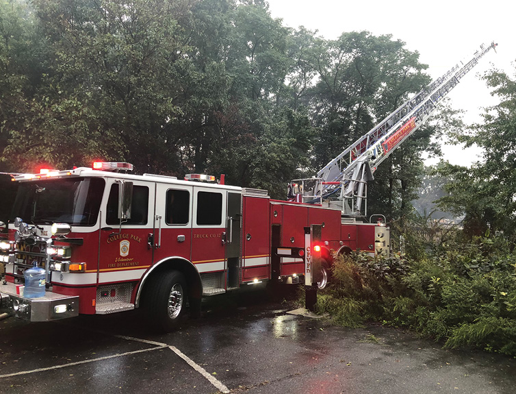 At the same incident, the truck company cut down a tree in the rear of the parking lot to open access to the building's side A. Since the entire parking lot was empty, backing in was easy and kept the front of the truck out of harm's way.