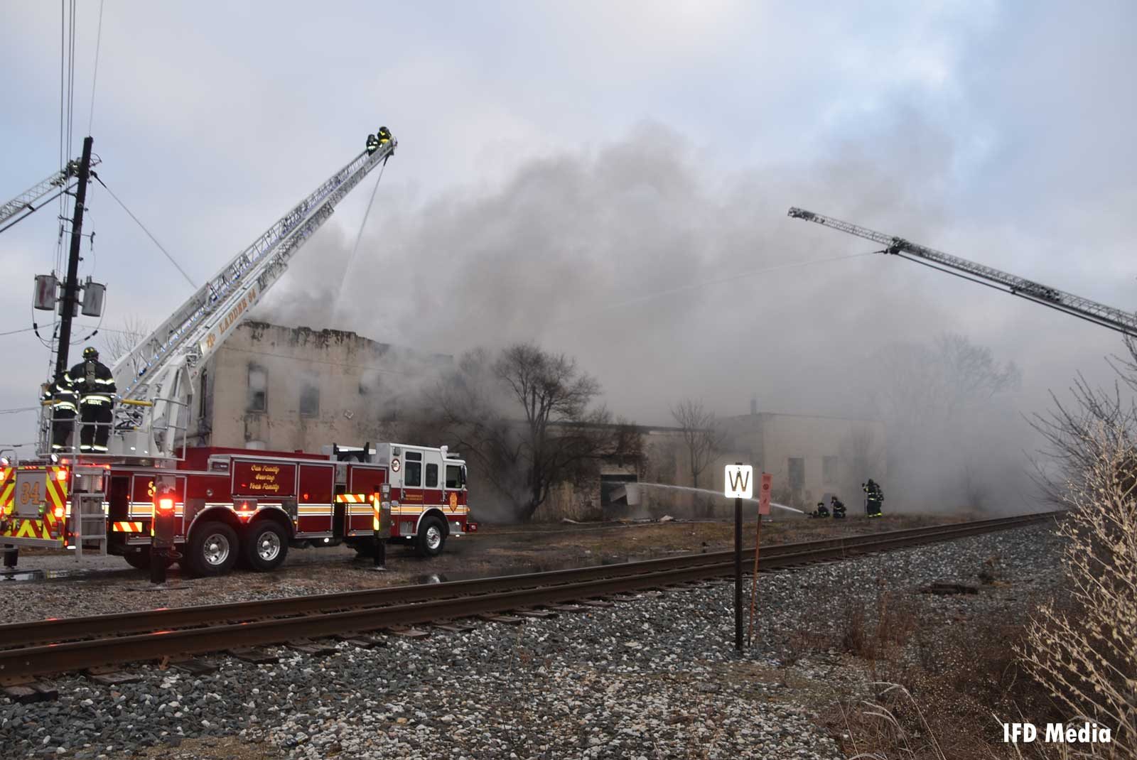 Multiple fire trucks and firefighters on scene of the fire in Indianapolis