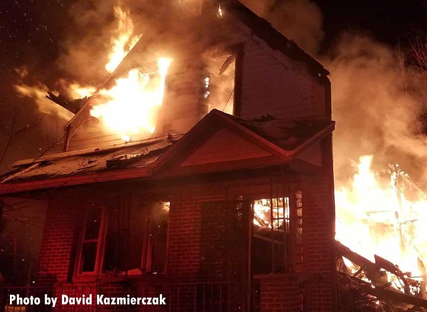 Flames shoot through a home in Buffalo New York