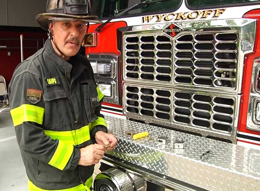 Mike Ciampo in front of a Wyckoff fire truck
