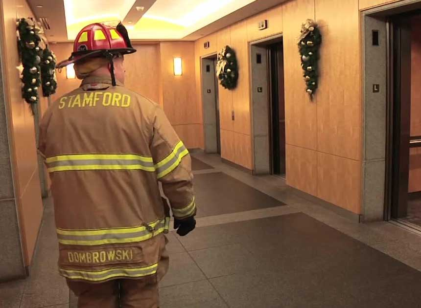 A firefighter using elevators
