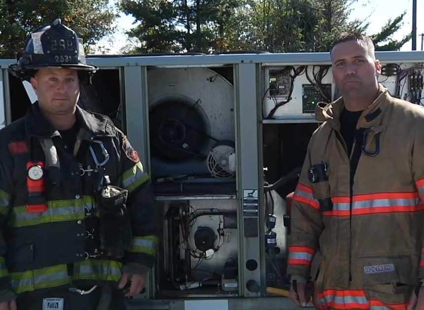 Anthony Deko and Adam Hansen on HVAC rooftop units