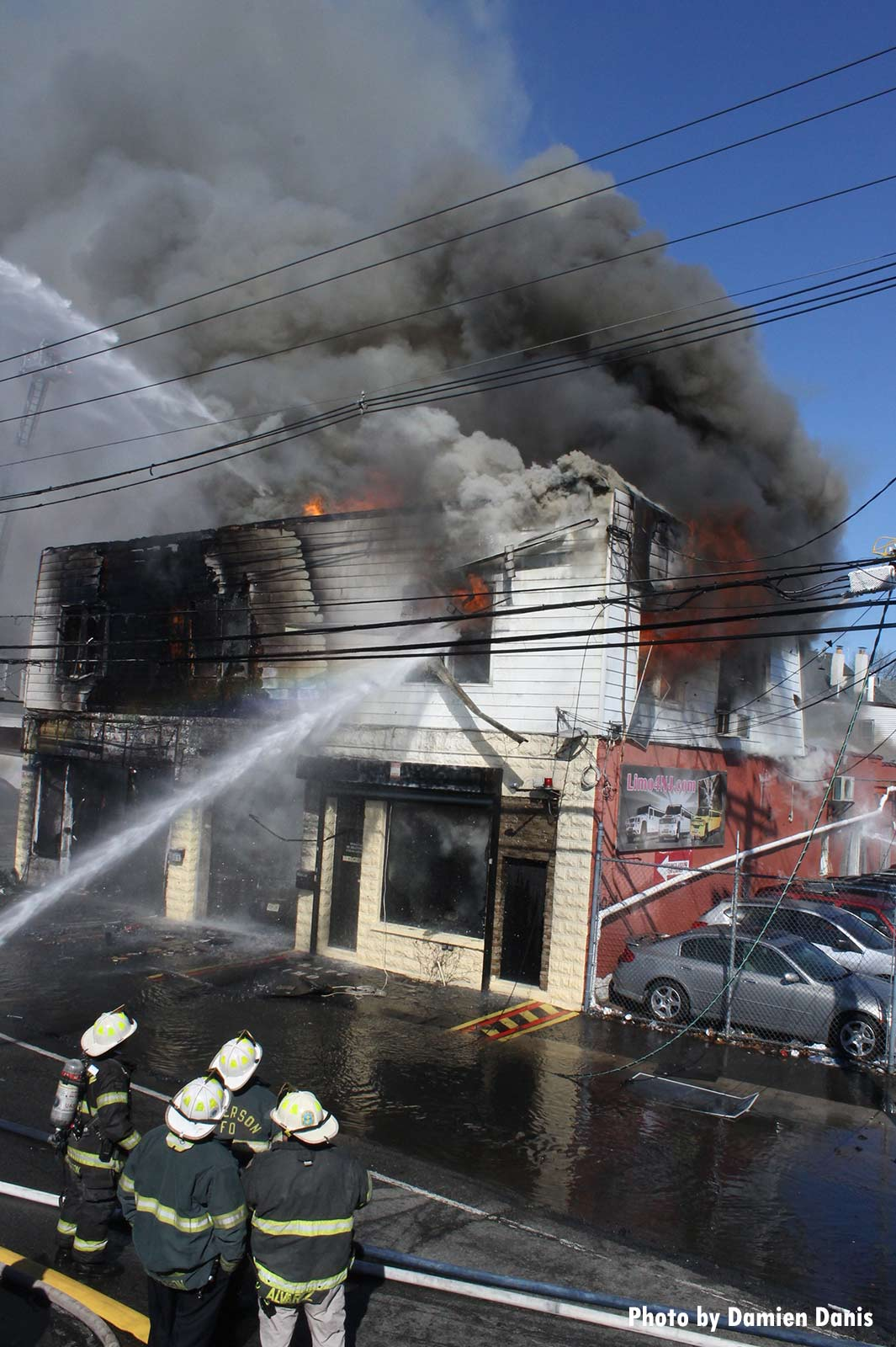 Firefighters pour water on a raging fire in Paterson, New Jersey
