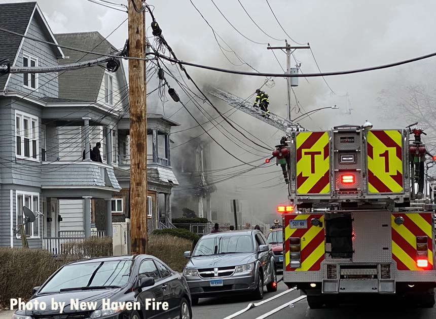 Firefighter on aerial ladder at New Haven fire