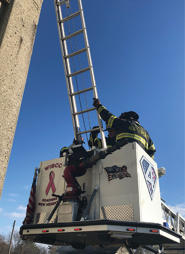 Ensure that the ladder won't hit the bucket's controls; this bucket's controls were moved out of the center to allow the ladder to sit properly.