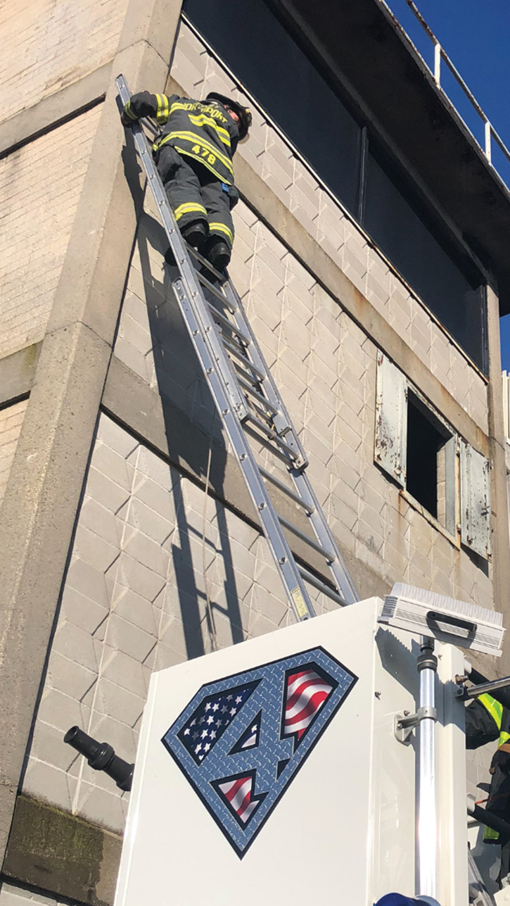 The portable ladder is resting on the rung, simulating the rescue of a victim in a tree, which you may have to do in a lifesaving operation. Always inspect ladders after their use.
