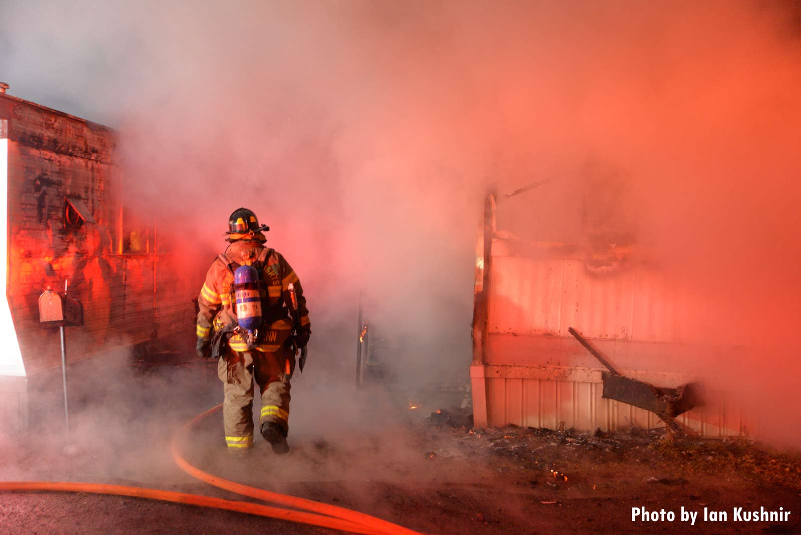 Firefighter amid smoke during a trailer fire