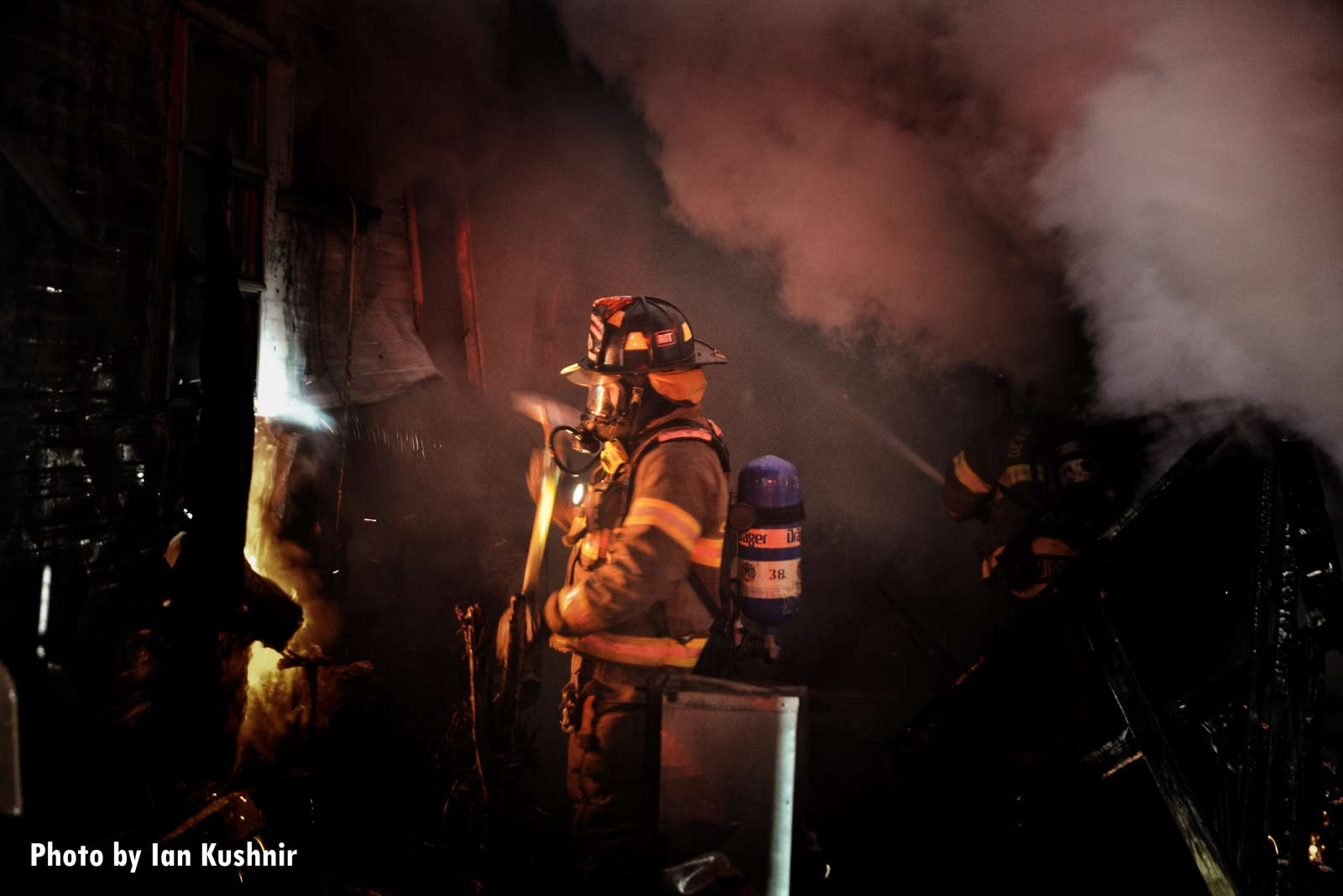 A firefighter with an ax working on the fireground